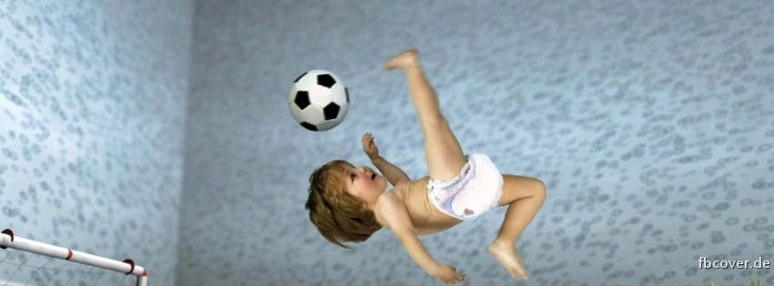 Football - A baby playing football.